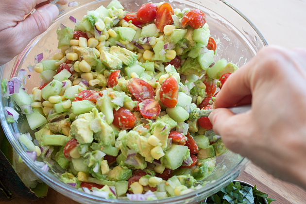 Mixing Corn Avocado Salsa